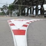 The Pit Lane Exit Rubber Stripes