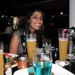 Neha admiring her drinks selection