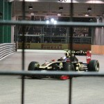 The Russian, Vitaly Petrov, flying around the corner in his Lotus Renault
