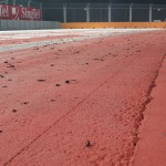 The rubber remnants all over the track of the last turn...